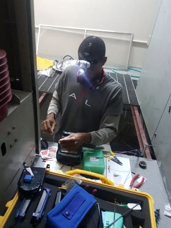 Young professional and Virgin Islander Val I. John hard at work as a certified Fibre Optics Installer. Photo: Provided