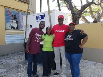 Third from left Kevin R. Gordon, CEO of Digicel and Principal of Althea Scatliffe Primary School, Marieta Headley after receiving a new generator from Digicel on October 3, 2017. Photo: Provided