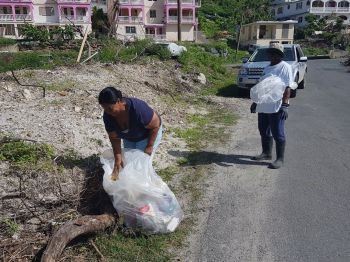 Members of the West End community seen cleaning up. Photo: Provided