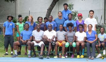 Coach Xavier 'Dag Samuels with some of his athletes of the Fast Lane Track Club. Photo: Provided