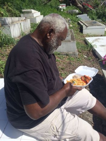 Mr MacDonald Smith having lunch after working tirelessly to clean-up the burial grounds in West End. Photo: Provided
