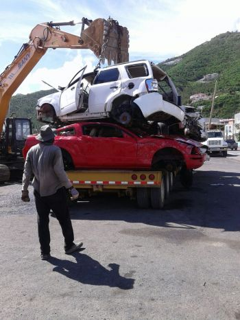 Damaged vehicles being removed from the waterfront on the main island of Tortola today, November 12, 2017. Photo: VINO