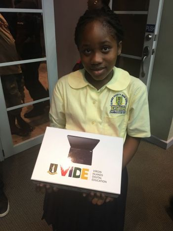 Deanaidia Greenaway, grade 7 student of the Elmore Stoutt High School (ESHS) is happy to receive her new digital textbook VIDE. Photo: Provided