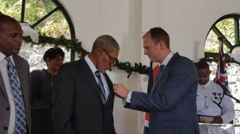 Pastor Cromwell O. Hodge being pinned with the 2017 BVI Badge of Honour by Governor Augustus J. U. Jaspert on December 12, 2017. Photo: VINO