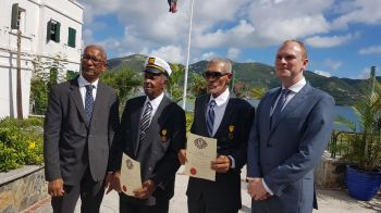 The Honourees, Captain Wendel W. Parsons and Pastor Cromwell O. Hodge, are flanked by Premier Dr The Honourable D. Orlando Smith (AL), left, and Governor Augustus J. U. Jaspert. Photo: VINO