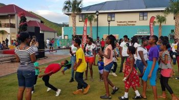 Enjoying some 'Limbo' at the Tree of Hands Foundation's Christmas event at Tortola Pier Park on December 16, 2017. Photo: Digicel