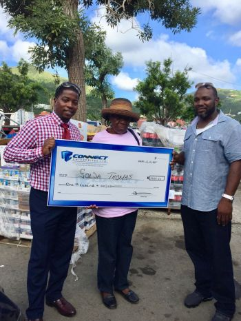 Ms Golda Thomas, centre, was one of the five beneficiaries of $1000 from local businessman Mr Clive George, right.