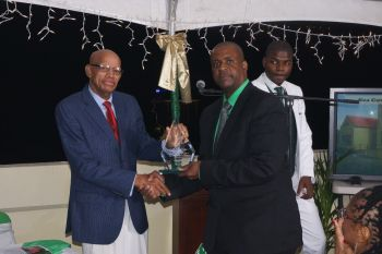 It was on March 4, 2017 that the Virgin Islands Party, under its Chairman Hon Andrew A. Fahie (R1), right, honoured one of its Founding Members, Mr Omar W. Hodge, left. Photo: Provided