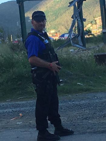 An armed overseas police officer in the Virgin Islands. Many persons felt the curfew was only violating their rights as it was not an effective crime fighting strategy, according to statistics. Photo: Team of Reporters