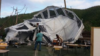 High winds on January 6, 2018 brushed aside the tents erected at the Capoon's Bay Basketball Court for the primary school in the First District. Photo: Provided