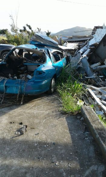A damaged car at the site of the destroyed Belle Vue Gym on Tortola. Photo: VINO