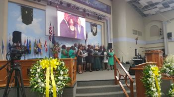 Virgin Islands Party (VIP) members pay tribute in song to fallen member Mr Omar W. Hodge. Photo: VINO
