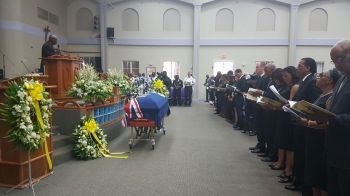 The flag draped casket bearing the body of the late Omar W. Hodge. Photo: VINO