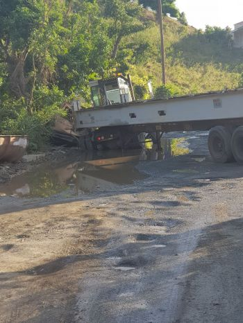 Persons have long complained about the deplorable state of the stretch of road between Qwomar Trading Limited and Crystal Night Club and Bar in Free Bottom and as recent as January 31, 2018 a trailer truck got stuck in one of the huge mud-filled potholes. Photo: Team of Reporters