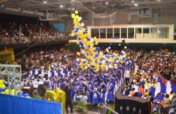 Shermel S. Maduro-Skelton had the big and proud task of decorating the Multi-Purpose Sports Complex for the graduation ceremony of Elmore Stoutt High School. Here fine work was topped off with a balloon drop, much to the thrill of those in attendance. Photo: Provided