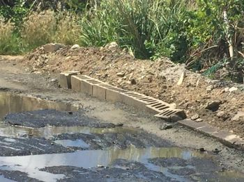 Concrete blocks placed on the side of a portion of Lee Road on Virgin Gorda to prevent water from further damaging the road. Photo: Team of Reporters