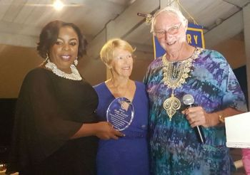 Vivian Westwood (centre), daughter of Mr Neville C. Westwood accepting an award on his behalf from Karia J. Christopher (left), President of the Rotary Club of Tortola and Mr Michale D. Riegels QC (right), Lawyer and Past President. Photo: VINO