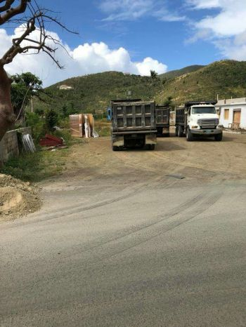 The paving of the main thoroughfare in Sea Cows Bay is being done by the Government run-Public Works Department and Tortola Paving Limited. Photo: Team of Reporters