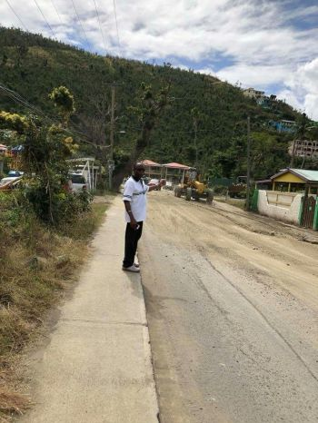 Third District Representative Hon Julian Fraser RA (in photo) will be breathing a sigh of relief now that the road in Sea Cows Bay is finally being paved. Photo: Team of Reporters