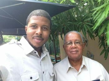 Late Mr Elton George (right) with his son Kamau A. Georges (left). Photo: Facebook