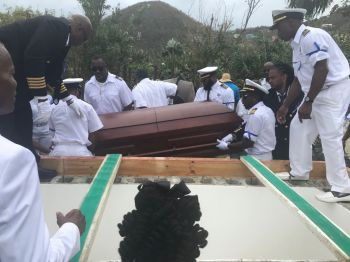 His pallbearers were a mixture of current boat captains and family members all decked out in their white captain uniforms with hats. Photo: Team of Reporters
