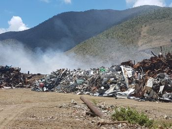 A fire that erupted on May 9, 2018, almost three weeks ago, at a temporary dumpsite in Cox Heath, on the western side of Tortola is still burning. Photo: Team of Reporters