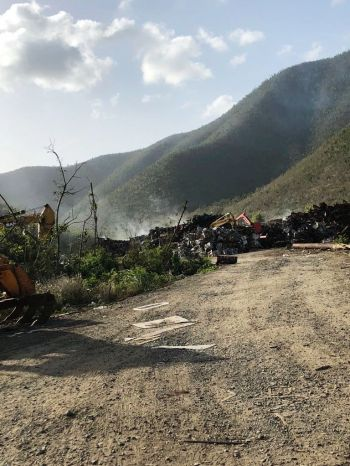 Smoke billows on June 3, 2018 from the makeshift dumpsite in Cox Heath, on the western side of Tortola. Photo: Team of Reporters