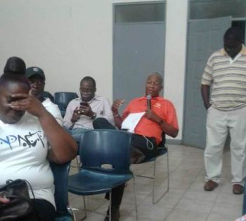 Claude O. Skelton-Cline (right), former Managing Director of BVI Ports Authority and social commentator during the question and answer section of the public meeting. Photo: Team of Reporters