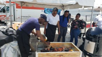 The Virgin Islands team opted to do the whole pork roast, which was a major attraction to many, before it was pulled to pieces to make a local styled dish. Photo: Team of Reporters