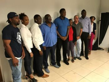 Newly elected President of the BVI Basketball Federation (BVIBF), Mr Derrick R. Varlack, 4th from left, and Vice-President Jason A. Edwin, 5th from left, are flanked by members of the new executive body. Photo: Team of Reporters