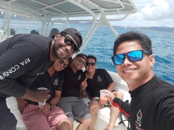 Cortez Forbes having some leisure time with some of his staff of Rufred Forbes and Associates (RFA). Photo: Provided