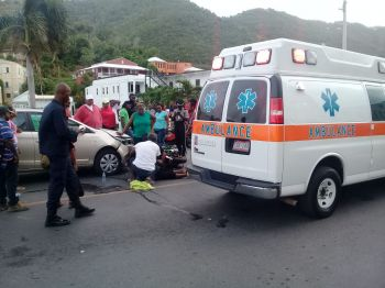 An ambulance arrives to take the injured rider to Peebles Hospital, following an accident on Waterfront Drive, Tortola on July 9, 2019. Photo: Team of Reporters