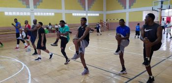 Captain of Bayside Blazers, Jason A. Edwin, right, takes his team through a warm-up session this morning, July 14, 2019 ahead of their opening game of the 6th Annual 'Battle of the Fittest' Basketball Tournament in St Maarten tonight. Photo: VINO