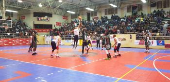 The tip off between BVI Bayside Blazers (green) and Dominican Republic at the 6th annual 'Battle of the Fittest' Basketball Tournament in Philipsburg, St Maarten on July 15, 2019. Photo: VINO