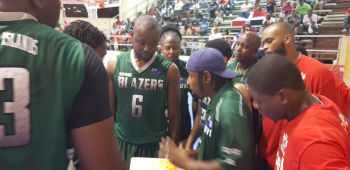 BVI Bayside Blazers huddle for a strategy talk with Head Coach Ronald Simmons aka 'Gola' (with cap) after staring defeat against Dominican Republic on July 15, 2019. Player with #6 singlet is Dextroy D. Manswell. Photo: VINO