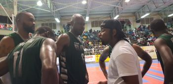 Head Coach Ronald Simmons aka 'Gola', right, speaking to the BVI Bayside Blazers players in their tough matchup with Dutch St Maarten on July 18, 2019. Photo: VINO