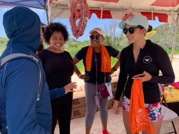 Junior Minister for Tourism Honourable Shereen D. Flax Charles, 2nd from right, converses with guests at Xmas in July at White Bay, Jost van Dyke on July 28, 2019. Photo: VINO