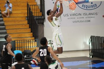 Eral Penn slam dunks for the Virgin Islands in one of their games at the Paradise Jam Tour in St Thomas, US Virgin Islands. Photo: Team of Reporters