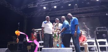 Experienced fisherman Robin Smith, left, is presented with his trophy for the Most Overall Catch (209lbs) in the Oliver Turnbull Fisherman's Tournament by Premier and Minister of Finance Hon Andrew A. Fahie (R1) in the presence of Mr Oliver Turnbull aka 'Ollie' and Minister for Culture Dr The Hon Natalio D. Wheatley (R7), right, Photo: VINO