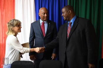 Premier and Minister of Finance Honourable Andrew A. Fahie (R1), right, is greeted by an attendee of the launch of the 'Back to the Sea' Maritime Industry Training Programme on August 14, 2019. At centre is Minister for Natural Resources, Labour and Immigration, Hon Vincent O. Wheatley (R9). Photo: GIS