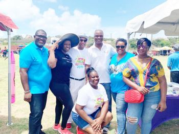 Members of Rotary, including Minister For Natural Resources, Labour and Immigration, Hon Vincent O. Wheatley (R9), 3rd from left, at the Back to School Fiesta on Virgin Gorda on August 24, 2019. Photo: VINO