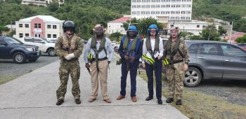 Second from left: Deputy Director of Public Works Mr Kurt Hodge, Minister for Public Works, Transportation and Utilities Hon Kye M. Rymer ((R5) and Governor Augustus J. U. Jaspert are flanked by soldiers of the Royal Navy prior to commencing an ariel inspection of the terrirory following the Passage of Hurricane Dorian. Photo: VINO