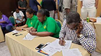 Former legislator Archibald C. Christian, right, was one of the volunteers registering pledges made at the Rotary telethon for Bahamas relief at Maria's by the Sea on September 11, 2019. Photo: VINO