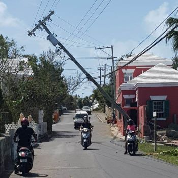 A compromised utility pole in Bermuda, following the passage of Hurricane Humberto. Photo: Team of Reporters
