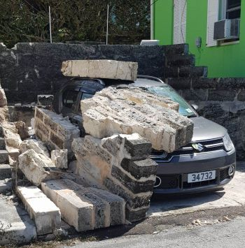 A wall collapses in Bermuda during the passage of Hurricane Humberto. Photo: Team of Reporters