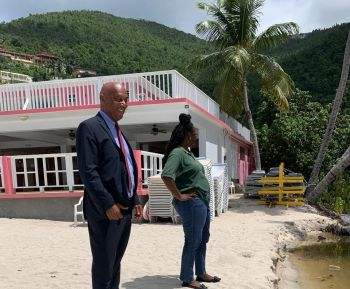 Deputy Premier and Minister for Natural Resources and Labour Honourable Vincent O. Wheatley (R9), left, seen here at Cane Garden Bay Beach on September 30, 2019, is appealing to everyone to put their health first by staying away from the closed Cane Garden Bay Beach until an 'all-clear' is issued. Photo: Team of Reporters