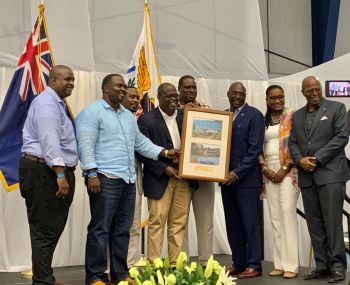 Speaker of the Virgin Islands House of Assembly (HoA), Hon Julian Willock, 4th from left, presented a gift Senate President of the 33rd Legislature Hon Novelle E. Francis (D), 3rd from right. Hon Willock called on both the Premier, Hon Andrew A. Fahie (R1), left, and the Opposition Leader, Hon Marlon A. Penn (R8), 2nd from left, to join him in presenting the gift, which he said was on behalf of the HoA. Photo: Team of Reporters