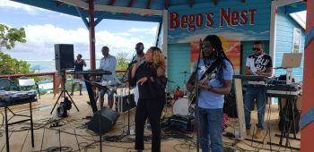 Junior Minister for Trade and Economic Development, Hon Shereen D. Flax-Charles adds to the hype through lyrics at the Big Bamboo Restaurant at Anegada Lobster Festival 2019. Photo: VINO