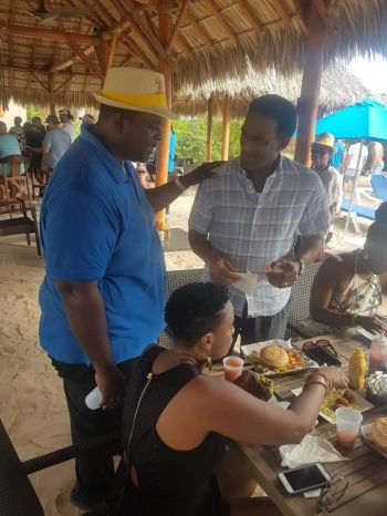 Premier and Minister of Finance, Honourable Andrew A. Fahie (R1) greets former legislator, Dr Kedrick D. Pickering at Anegada Lobster Festival 2019. Photo: VINO