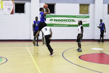 A player from Medics attempts a shot from way beyond the 3-point arc against Pure Playaz on October 26, 2019. Photo: VINO